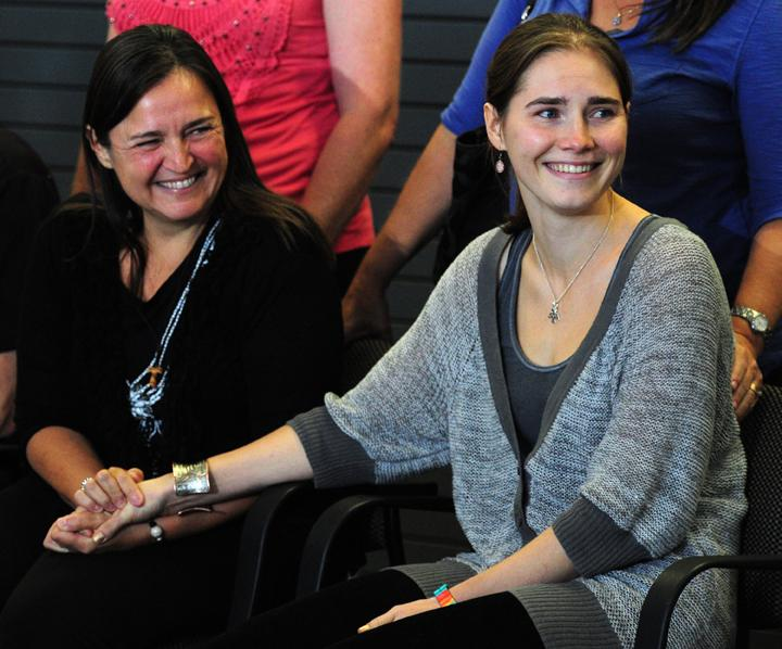 Amanda Knox, right, holds the hand of her mother Edda Mellas after arriving at Sea-Tac International Airport Tuesday, October 4, 2011, in Seattle, Washington. Knox was acquitted of murdering her roommate in Italy. (John Lok/Seattle Times/MCT)
