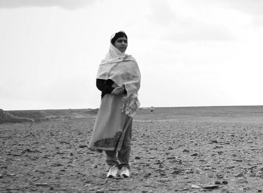 "Malala Yousafzai at the Jordan/Syrian border on Feb. 16, 2014, in a still from ""He Named Me Malala."" (Gina Nemirofsky/20th Century Fox)"