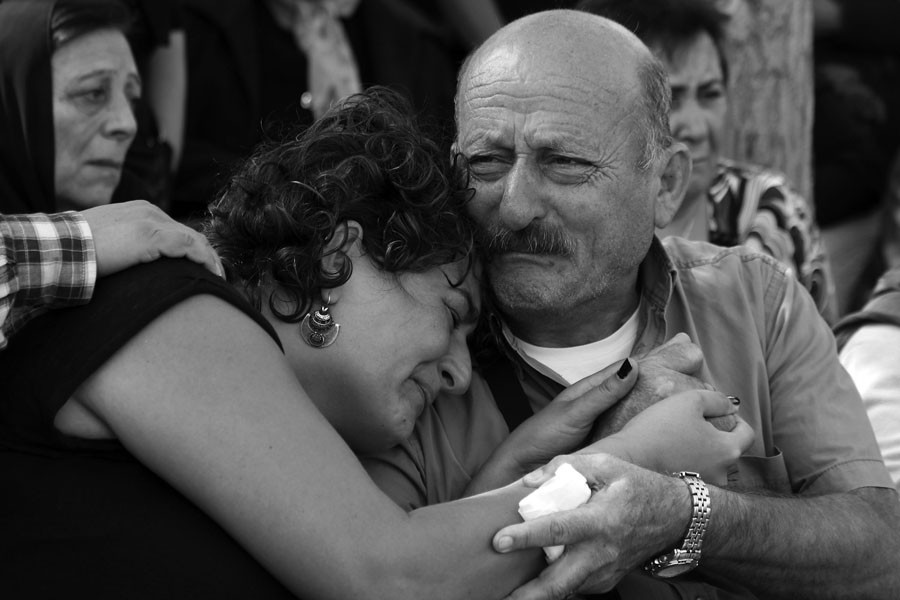 Oct. 11, 2015 - Ankara, Turkey - The family of Korkmaz Tedik, who was killed during the bomb attack in Ankara, mourn at the funeral as thousands of people gathered in the centre of Turkey's capital to mourn the victims of twin bomb blasts which killed at least 95 people on Oct. 11, 2015 in Ankara. (Tumay Berkin/Zuma Press/TNS)