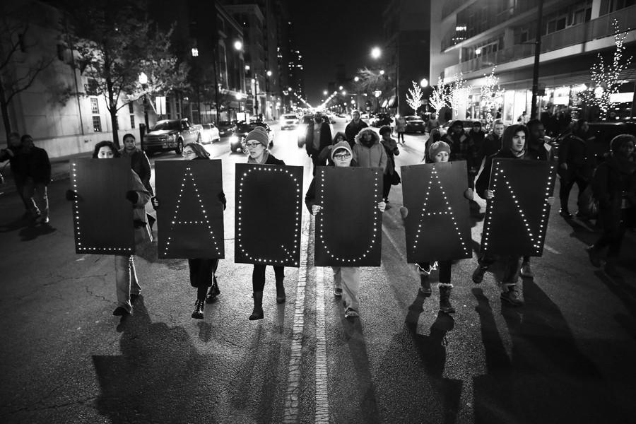 "Protesters form a line and walk holding signs that spell out ""Laquan"" following the release of a dash-cam video of 17-year-old Laquan McDonald being fatally shot 16 times by Chicago Police officer Jason Van Dyke, on Tuesday, Nov. 24 2015, in Chicago. (Chris Sweda/Chicago Tribune/TNS)"