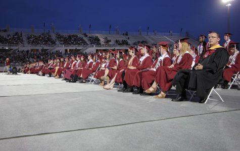 Grads walk across the stage