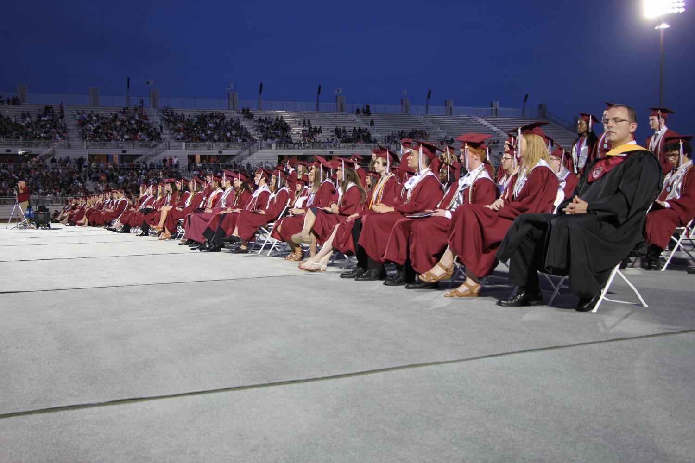 Grads+walk+across+the+stage