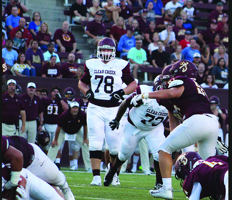 Offensive Tackle Chad Lindberg towers over Deer Park defenders.