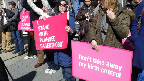 Supporters rally in favor of Planned Parenthood after Title X funding decision.