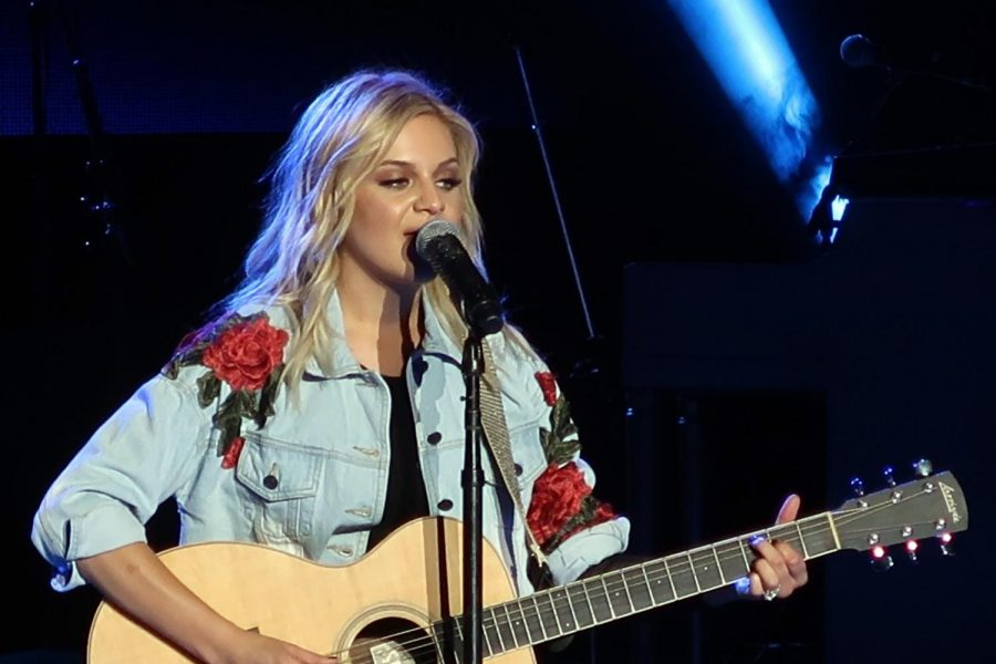 Singer-songwriter Kelsea Ballerini performing one of her songs in concert