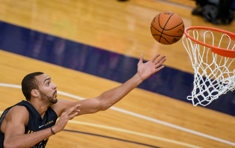 Utah Jazz player, Rudy Golbert, playing in a scrimmage at the Warrior Fitness Center