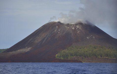 The Anak Krakatau volcano, located in Indonesia, erupting ash and smoke