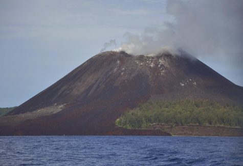 The Anak Krakatau volcano, located in Indonesia, erupting ash and smoke
