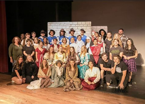 The Wildcat Theatre Department poses in their costumes.